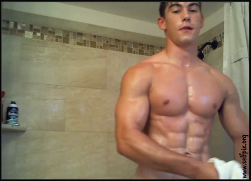 Young muscle stud jerks off